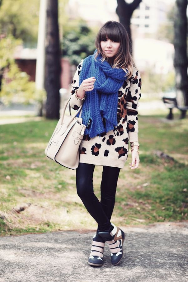 teenvogue:  Holiday shopping outfit inspiration: Fashion Click blogger Juliana S. stays comfy - yet super stylish! - in an oversized printed sweater layered over leather leggings. She finishes off her ensemble with a pair of cool hightops. Learn more about her look here »