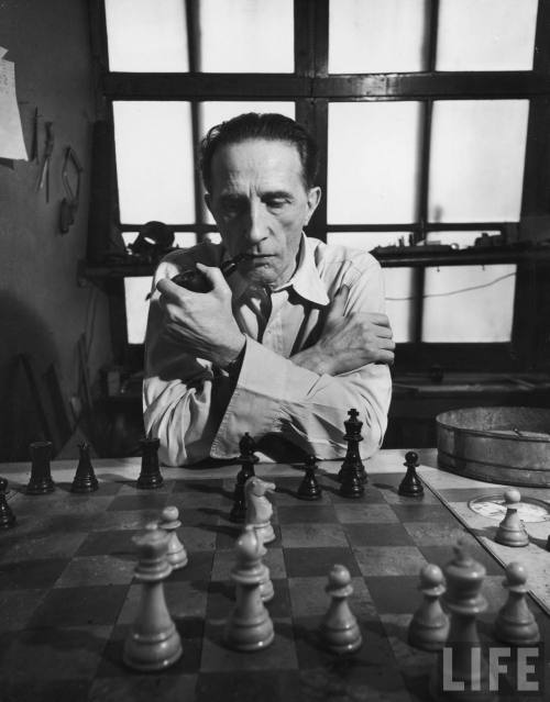 LIFE: Artist retired to his chess board Marcel… - Hosted by Google Artist retired to his chess board Marcel Duchamp, playing by the hour at a table with a clock that keeps track of the time between moves.