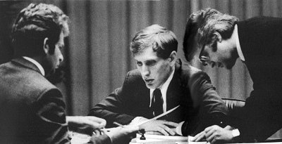 "The man who saved Fischer-Spassky Most chess fans know that Lothar Schmid was the arbiter at the match of the century between Bobby Fischer and Boris Spassky in Reykjavik in 1972 (shown in the picture above). Lothar was deeply involved in the match being successfully concluded. After Fischer had arrived late for game one he missed game two because he insisted in playing in a closed room. Schmid agreed to this condition for game three, but the American chess genius kept adding new conditions. Spassky became terribly angry and the match was on the verge of collapse. In this situation Lothar Schmid grabbed both GMs by the shoulders and forced them into their chairs. ""Now play chess!"" he shouted. Spassky obediently made the first move and the match could proceed. (via ChessBase.com - Chess News - The man who saved Fischer-Spassky)"