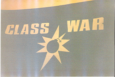 The old days. A 3 foot high banner made by hand with stencils built from laser outputs and a paint brush. The font is Compacta. The graphic was a Dingbat with my first and only Illustrator drawing around it. I wonder what happened to it. Thanks to DW for the pic.