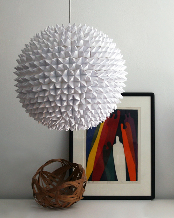 DIY Faceted Pendant Lights  Take a longing glance at this beautiful DIY faceted pendant sphere, completely covered in small fortune tellers! This project requires little more than printer paper and patience to complete, and would look stunning in an entry, a hallway, or a dining room