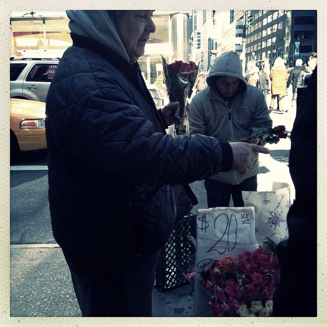selling flowers on valentines day. on Flickr.On Valentine's Day, vendors are lined up practically everywhere for people to buy their last minute roses. Some vendors go all the way with teddy bears, balloons, and chocolate as well.