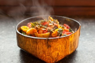 Kale Ratatouille: Shredded kale is added to the mix of this classic French dish which highlights the beauty of zucchini, tomatoes and fresh herbs. Serve this Kale Ratatouille over Black Rice with Shaved Scallions. This recipe comes to us from Stefanie Sacks ofStirring the Pot radio.