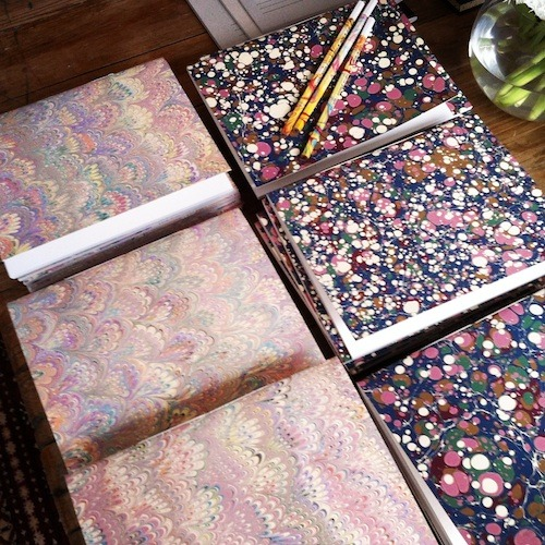 Parrot tulips and technicolor hand marbled and hand bound notebooks. Each is unique.