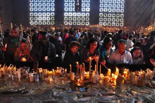 Pilgrims lighting candles in the basilica of Our Lady of Aparecida, Brazil.