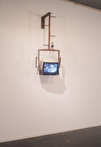 "The artist Julia Scher is known for her work with surveillance technologies. In 1993, Scher's video installation Mothers Under Surveillance was included in the exhibition ""The Final Frontier"" at the New Museum. A simultaneous broadcast of the gallery space is mixed with prerecorded footage of elderly women being tracked while they attend ""adult day care."" By including a date and time stamp, which functions as a sign for the ""reality"" of these images, the two streams of images merge into a single surveilled world. Scher creates an endless loop of people watching people while being watched themselves, with the aim of making visible the invisible systems of power and control enabled by electronic technology. Mothers Under Surveillance is on view in ""NYC 1993: Experimental Jet Set, Trash and No Star"" through May 26."