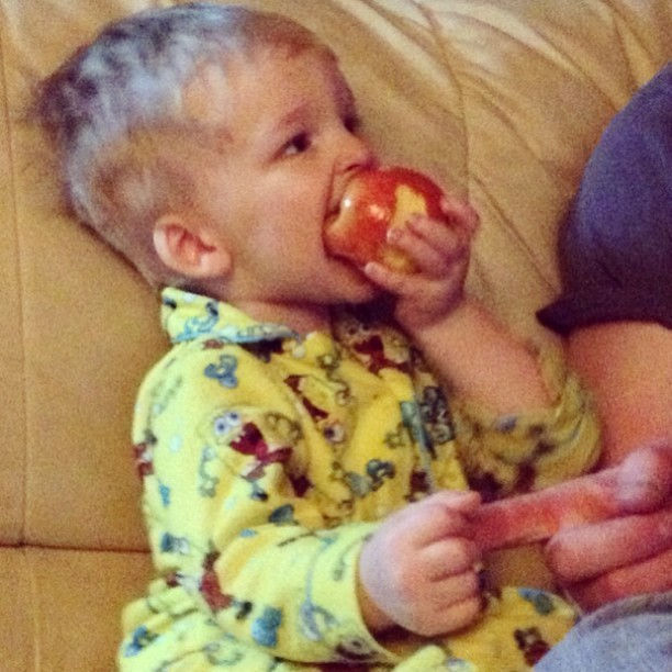 A boy, an apple, a firm grip on dad. I wish for simpler things in 2013.