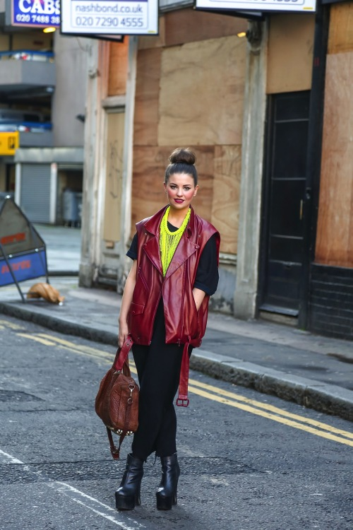 Team a statement neon necklace over a black maxi and biker vest for style perfection.
