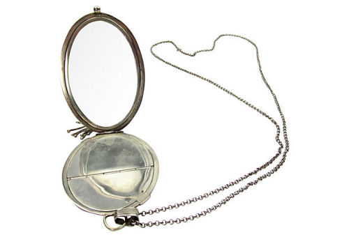 "Large sterling silver compact pendant with mirror, two gold washed compartments, beautiful engraving on exterior and silver fringe hanging from one end. Large bale and ball clasp finish the other end with an elegant long sterling silver chain on which hang it, 36""L. Stylized G or C monogram engraved on front with floral swag decoration over Art Deco machine engraving that appears on both sides. by Ruby + George on One Kings Lane Vintage and Market Finds"