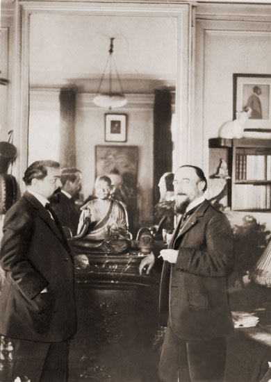 hazel-motes:  jeudecartes:  Satie & Debussy (juin 1911)  Satie liked to adopt stray dogs, despite living in a small upstairs apartment. He joined the Communist party mainly to annoy people. He also liked to doodle on his music scores. When he died his friends moved his piano from the wall to find piles of music and sketches that had fallen down the back.