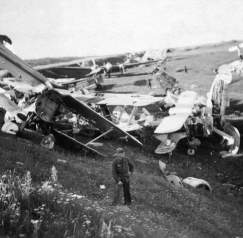 """A huge number of broken and destroyed Soviet planes. The airfield in Minsk was occupied by the German forces in the beginning of July 1941."" (via)"