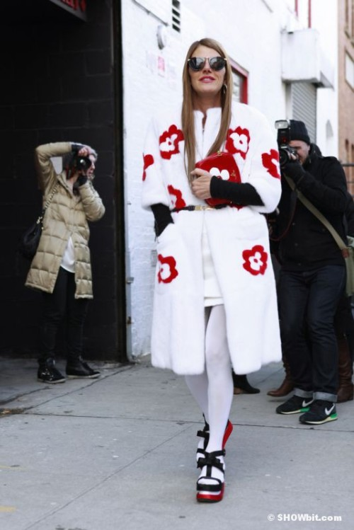 Anna dello Russo at #NYFW wearing Prada S/S 2013 fur coat, bag and Shoes, Pomellato;earrings and necklace, Celine;belt