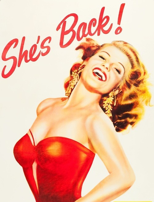 Rita Hayworth, Affair in Trinidad, 1952. 'She's Back!' refers to how Rita had not starred in a movie for 4 years prior.
