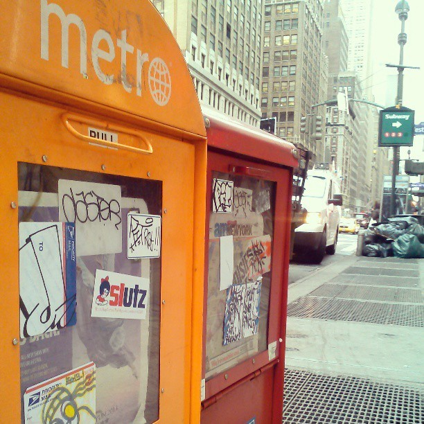 Metro & AM NewYork… the Coke and Pepsi of free newspapers. #Midtown #Manhattan #stickers #graffiti #NYC My last 3 pics will be on the way home… I work in Jersey! - posted in NYCbaton's instagram account. http://instagr.am/p/WhYfIbu2f7/