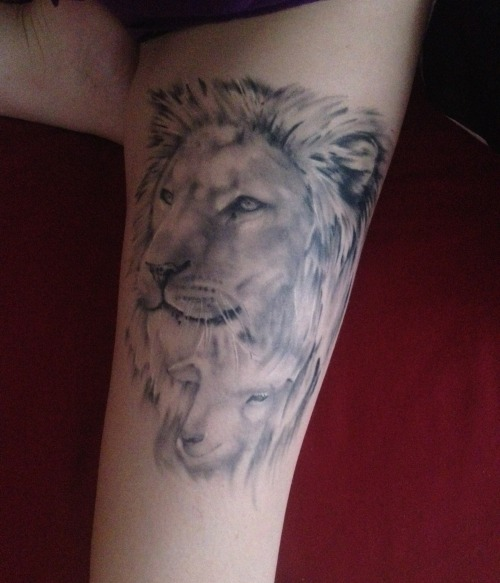 fuckyeahtattoos:  Ever since I was a little girl I had been obsessed with the tale of the lion and the lamb. How two animals so different could love one another was always a strange concept to me. I suppose the tattoo resembles love in unnatural places and the fact that your supposed 'enemy' might not in fact be your enemy. Lion and Lamb - Kim Dibble. By Kye Stacey at Exclusive Tattoos Studio, Street- England.