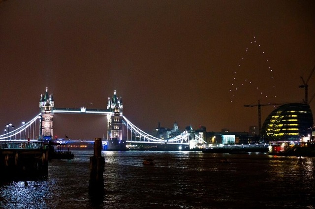 thisistheverge:  Drones form giant, glowing Starfleet insignia over London Over the weekend, the studio behind Star Trek Into Darkness took the film's title literally, commissioning the flying of a giant, glowing Starfleet insignia in the London night sky. Comprised of 30 LED-illuminated quadrotors, the 308-foot-tall logo rotated in place 118 feet above ground (video below), before dimming its lights alongside those of Tower Bridge and Big Ben in recognition of the WWF's Earth Hour conservation effort.