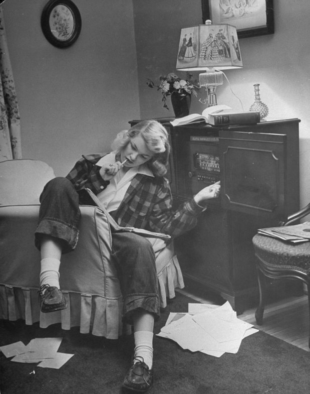 "lostsplendor:  The Invention of Teenagers by Nina Leen: ""Pat Woodruff does homework with the radio going full blast"", Missouri, 1944 (via LIFE) To all of you out there in the midst of finals."