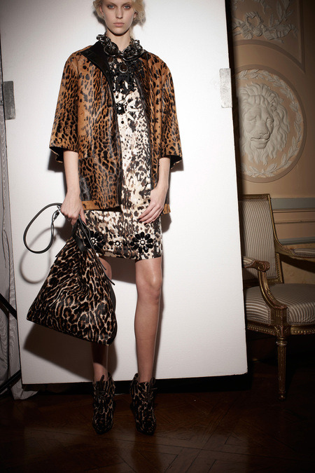 Love for Lanvin Pre-Fall 2013 collections have just begun and one thing is clear: animal prints aren't going anywhere. From Givenchy cowhide to Lanvin leopard, critters are the print du jour. Above, is a look from Lanvin — a veritable feeding frenzy of three different animal-inspired motifs, playing against one another while remaining oddly complementary. In addition to taking prints to the maximum this season, Lanvin was perfectly luxe with their play of textures, blending wools, furs, silks, and leathers into outfits to die for. To see the rest of the collection, click here. (Photos courtesy of Lanvin. Text by Jenny Bahn)