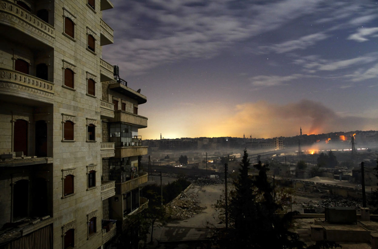 From Syria's Long, Destructive Civil War, one of 40 photos. Smoke rises in the Hanano and Bustan al-Basha districts in the northern city of Aleppo as fighting continued through the night, on December 1, 2012. A large rebel force launched an offensive on one of the few army bases in northwestern Syria still in the hands of loyalist forces and as fighting near Damascus closed the main road to the airport. (Javier Manzano/AFP/Getty Images)