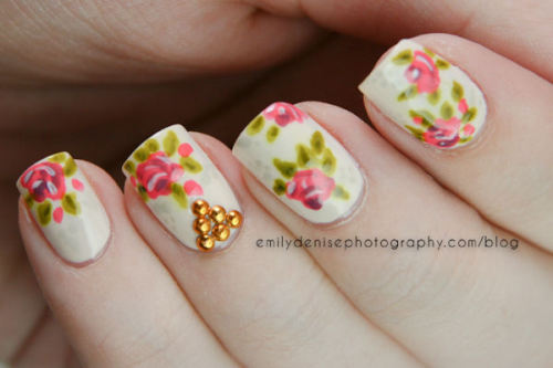 nailsbyveryemily:   Studded floral nails, using beautiful studs from KKCenterHK. Head over to my blogpost for more details!