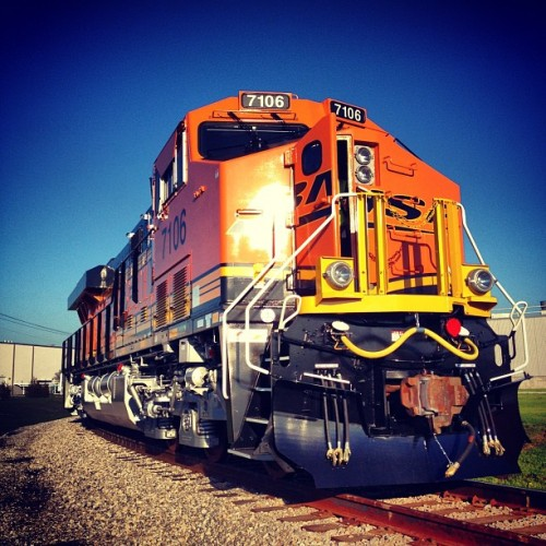 brianest:  generalelectric:  A new Evolution Series locomotive being transferred from GE Transportation's test track to BNSF tracks for pickup.  it has a mustache
