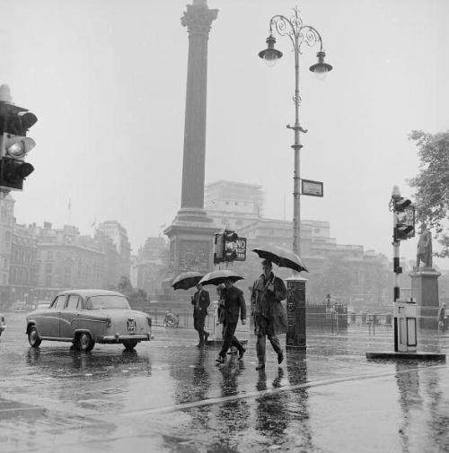 undr:  Moore/Stringer Pedestrians struggle through Trafalgar Square, London, in the rain. 1962