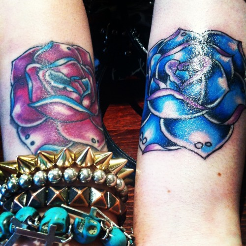 My matching rose tattoos done in the same colours but inverted for each arm. The blue rose was done on Sunday and the purple rose was done beginning of feb and fully healed. I love them :D