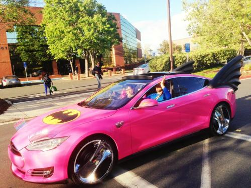 "shortformblog:  Some pranksters did some work on Sergey Brin's Tesla Model S, and oh is it magic. (When clicking on the link, crank up this track at the same time.)  Cue Bruce Wayne voice: ""Does it come in hot pink?"""