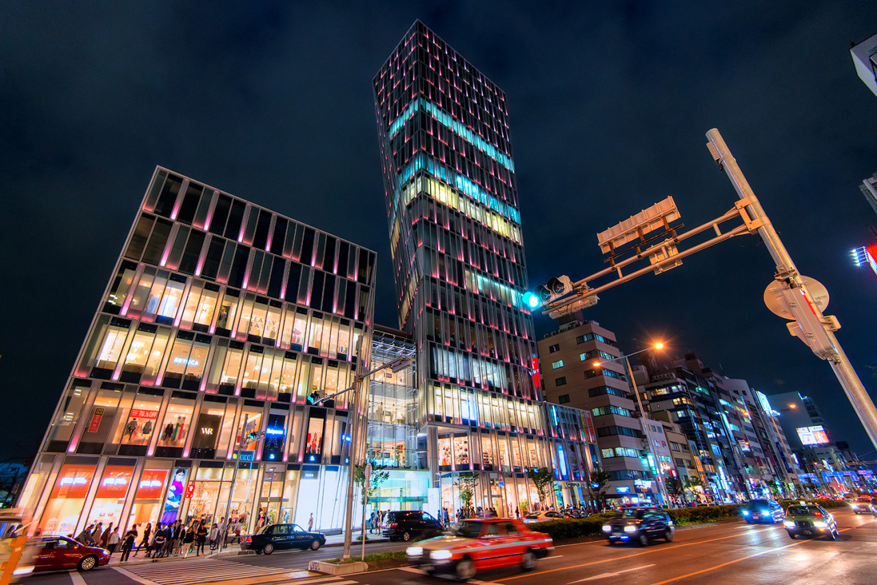 The AO Building in Aoyama at night. The RMK flagship shop is on the front of this building.