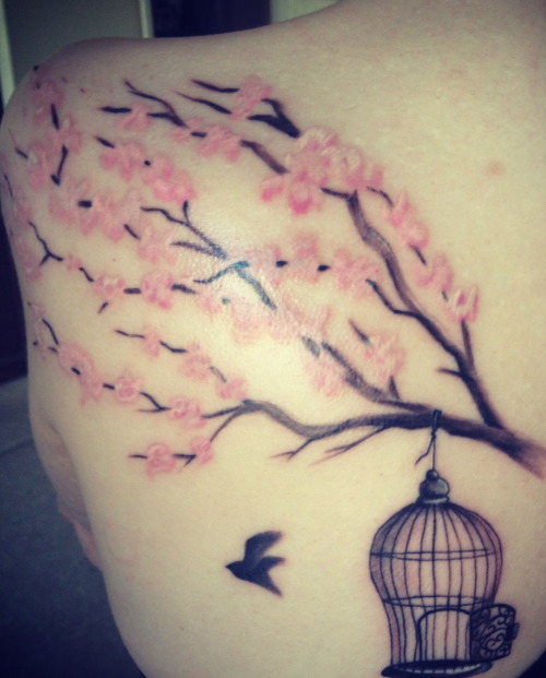 This is my 3rd tattoo. It is of a cherry blossom branch, open bird cage, and bird flying free on my left shoulder blade. I had it done at Outsiders Ink in Tulsa, OK by Austin McCullough.