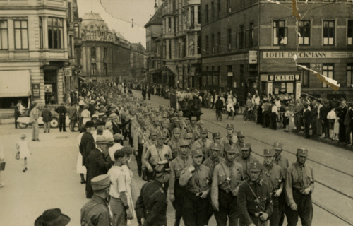 Nazi soldiers march through the streets of Bremen, (USHMM) Germany in 1932.