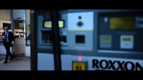 Phil Coulson making a pit stop at a Roxxon station.