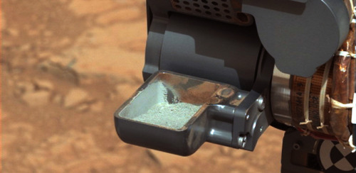 Mars rover confirms 1st drilled Mars rock sample NASA:   NASA's Mars rover Curiosity has relayed new images that confirm it has successfully obtained the first sample ever collected from the interior of a rock on another planet. No rover has ever drilled into a rock beyond Earth and collected a sample from its interior.   Photo: Image from NASA's Curiosity rover shows the 1st sample of powdered rock extracted by the rover's drill. (NASA/JPL-Caltech/MSSS)