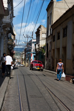 Street View A Look at the Streets of Santiago de Cuba, which is the second largest City of Cuba and Capital city of Santiago de Cuba Province in the south-eastern area of the Island, some 870 km south-east of the Cuban capital of Havana. Canon EOS 40D 1/400s ISO 320 f/12.9 Santiago, Cuba Flickr - Twitter - Facebook - Google+ - Posterous - 500px Copyright © BorisJ Photography - Boris Jusseit - all rights reserved - please do not use this image on any media without my permission.
