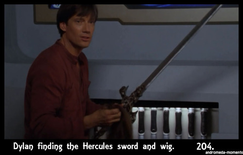 "andromeda-moments:  Andromeda Moment #204 Dylan finding the 'Hercules' sword and wig among his force lance stash in the hidden panel. ""It's a long story…"" 5x04, Decay of the Angel"