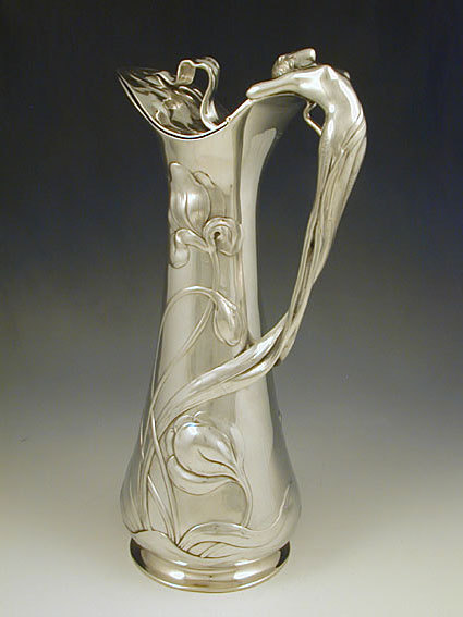 Manufacturer WMF  Description Polished pewter flagon with a handle in the form of a figural art nouveau mermaid Country of Manufacture Germany Date c.1906