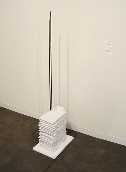 soulhospital:   Untitled - Doris Salcedo, 2012. The somber work hails from an important series representing the Columbian artist's interest in memorializing her home country's strife, which was cresting as the work was made. The neat pile of crisp white shirts is meant to evoke men in a funeral procession; the rebar lances that penetrate them are an obvious but potent signifier of violence. Currently on view at Art Basel - Alexander and Bonin. (via artinfo.com)