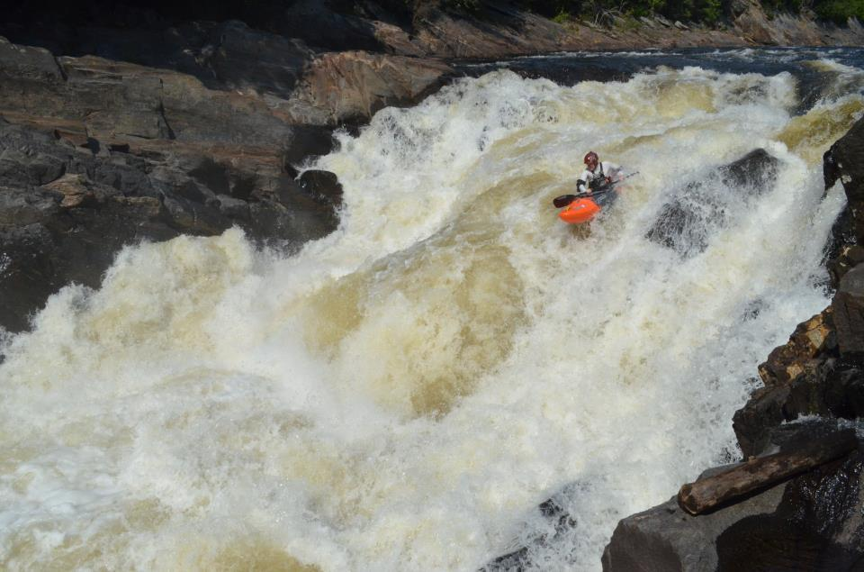 Brenton Petrillo fires up a gnarly stout on the Batiscan river in Quebec. Photo - Brian Kish