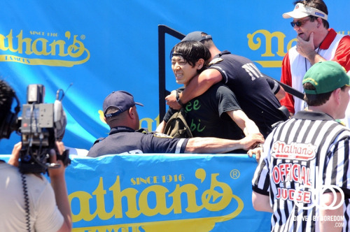 Takeru Kobayashi getting arrested at the Nathan's Famous Coney Island hot dog eating contest.