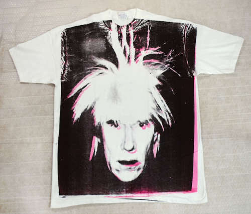 Warhol's T-Shirt Absolutely unique: this screenprint on a cotton t-shirt, created just months before his death, features Andy Warhol's famous Self-portrait (Fright Wig).