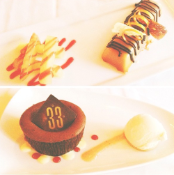 mickeyandminnie:  Club 33 desserts: butternut squash cheesecake in the shape of a Snickers bar (!) and a dark chocolate lava cake. MAH GAHD.