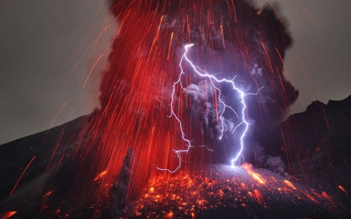 """A bolt of lightning flashes in an erupting volcano in Japan in this photo taken by German photographer Martin Rietze at Sakurajima volcano, Japan. Sakurajima had been silent for 100 years when there was a huge eruption in 1914 which swallowed up nearby islands and created an isthmus to the mainland, ending its life as an island. Sakurajima's rumbled into life again in 1955 and has been erupting almost constantly ever since."" I can't believe this is a real picture. It looks like that planet Mustafar, where Anakin Skywalker faces off against Obi-Wan Kenobi."