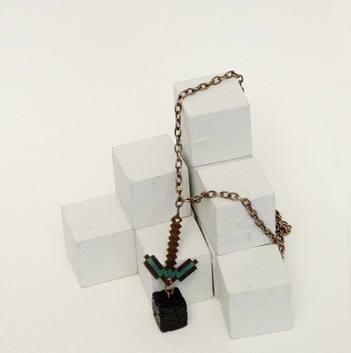raredropjewelry:  Minecraft diamond pickaxe with an obsidian block bead. I love this and definitely want to make more soon! I wore this out yesterday with some black milk lava printed leggings, I felt so put together.   >_<  Check out my jewelry :D
