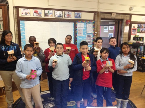 Some fourth and fifth graders with birdhouses they just made. Try it!  Instructions for making your own cardboard birdhouse here: http://vimeo.com/m/50849299