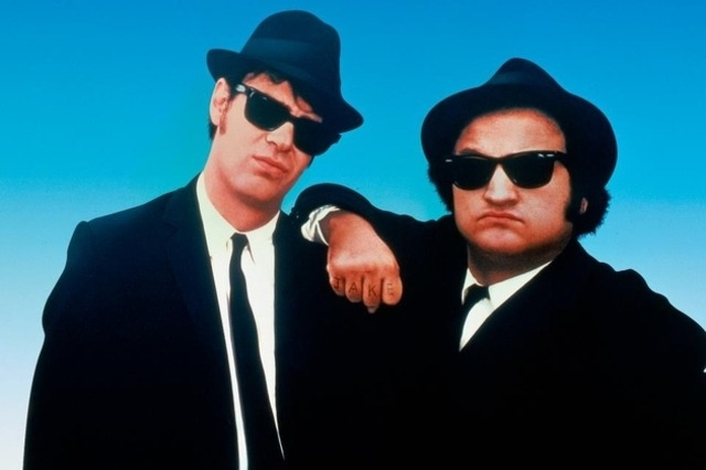 """The platonic love affair between John Belushi and Dan Aykroyd defies reason—Belushi, who scribbles ideas on wrinkled scraps of paper; Aykroyd, whose mad-scientist digressions are such that Belushi, when asked to translate their meaning, says, 'I have no idea.'"""