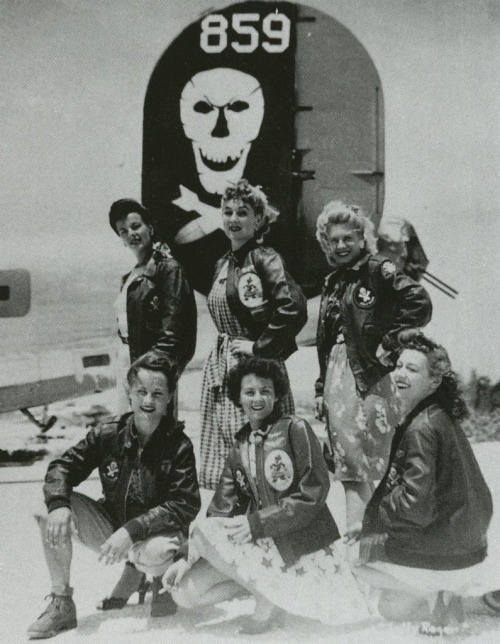 "rideartlife:  peerintothepast:  ""Six U.S.O. Girls wear A-2 jackets belonging to the 90th Bomb Group, a.k.a. ""Jolly Rogers,"" under a B-24 bomber. From the collection of John Campbell."" #WWII #History #USAAF #BomberJackets   My great-aunt flew with a B-25 squadron during WW-II. A courageous woman, she flew on every mission of that battle-scarred airplane, until it was decommissioned. They were a lucky crew, in a lucky plane, never to be shot down over the skies of Italy, Germany and France.   She was a pin-up, and graced one of the B-25s as nose art."