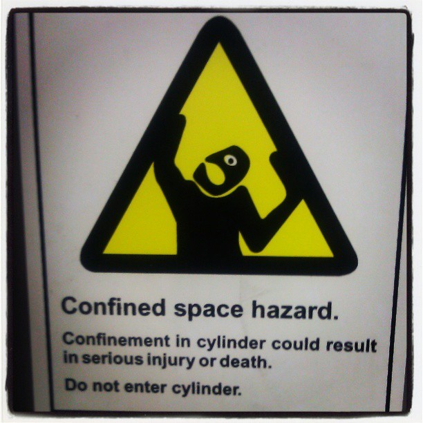 eighteenbelow:  kelsonv:  I love the expression on this #warning #sign on a laundromat washing machine.  I'm not a cyclops, so I'd probably be okay.  Hahaha!  I was thinking Picasso, but looking at it that way makes it even weirder!