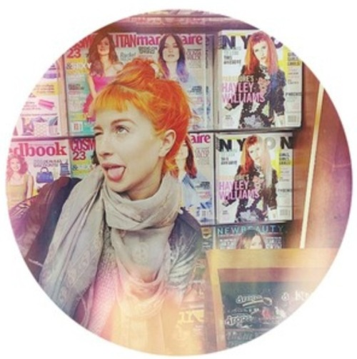 The gorgeous Hayley Williams posing In front of April's gorgeous issue of Nylon
