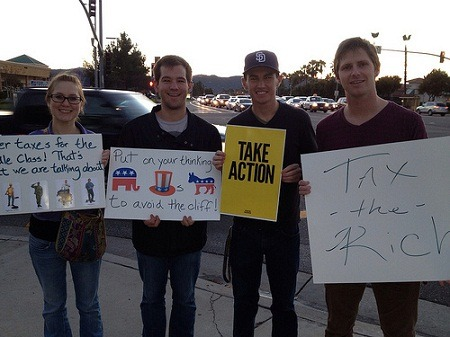 Temecula: Local residents rally against Fiscal Cliff   Local residents gathered in solidarity to support President Obama as the Senate's top Democrat and Republican leaders meet this weekend to work out the final details to keep America from going over the Fiscal Cliff.