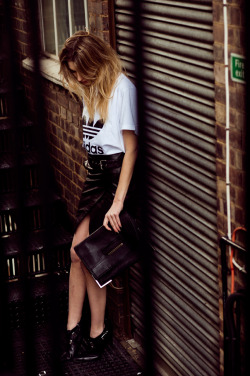 what-do-i-wear:  an Adidas mens t-shit via Zalando, an Elin Kling x Guess by Marciano leather skirt (similar here or here) and buckle booties, and a 3.1 Phillip Lim clutch.  (image: camilleovertherainbow)